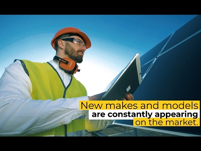 Man in safety gear evaluates a large solar panel. On screen text: New makes and models are constantly appearing on the market.