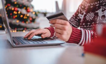 Person online shopping is about to make a purchase with credit card.