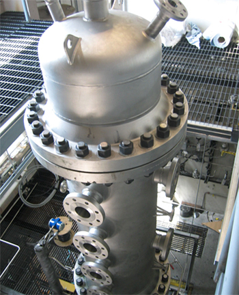 A photograph of the high pressure pilot scale gasifier. Measurement ports can be seen along the side