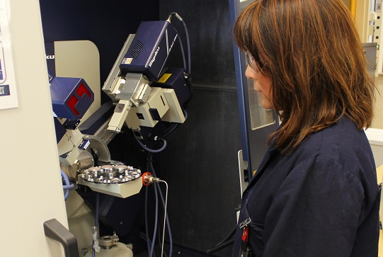 A scientist uses a powder x-ray diffraction (PXRD) spectrometer to determine and quantify phases present in a variety of energy R&D related samples