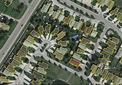 View of Automatically Extracted Buildings layer superimposed on a satellite imagery.