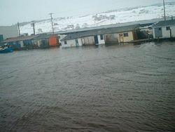FIGURE 23: Flooding in St. Lawrence, NL., due to storm surge from Placentia Bay, February 2004, triggered by southwesterly wind (from Southern Gazette, Marystown, NL).