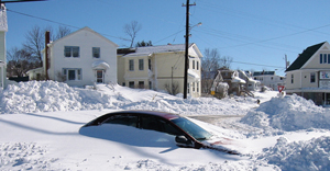 Photo of car covered in snow drifts