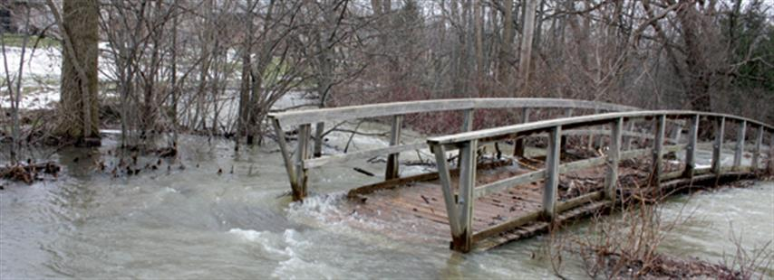 Photograph of washout of wooden pedestrian bridge in London, Ontario