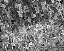 Shown here is a radar image acquired July 7, 1992 by the European Space Agency (ESA) ERS-1 satellite. This synoptic image of an area near Melfort, Saskatchewan details the effects of a localized precipitation event on the microwave backscatter recorded by the sensor.