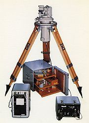 Gyro-theodolite setup with instrument on a tripod and consoles on the ground