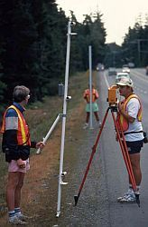 Technicians working on a levelling survey on the roadside