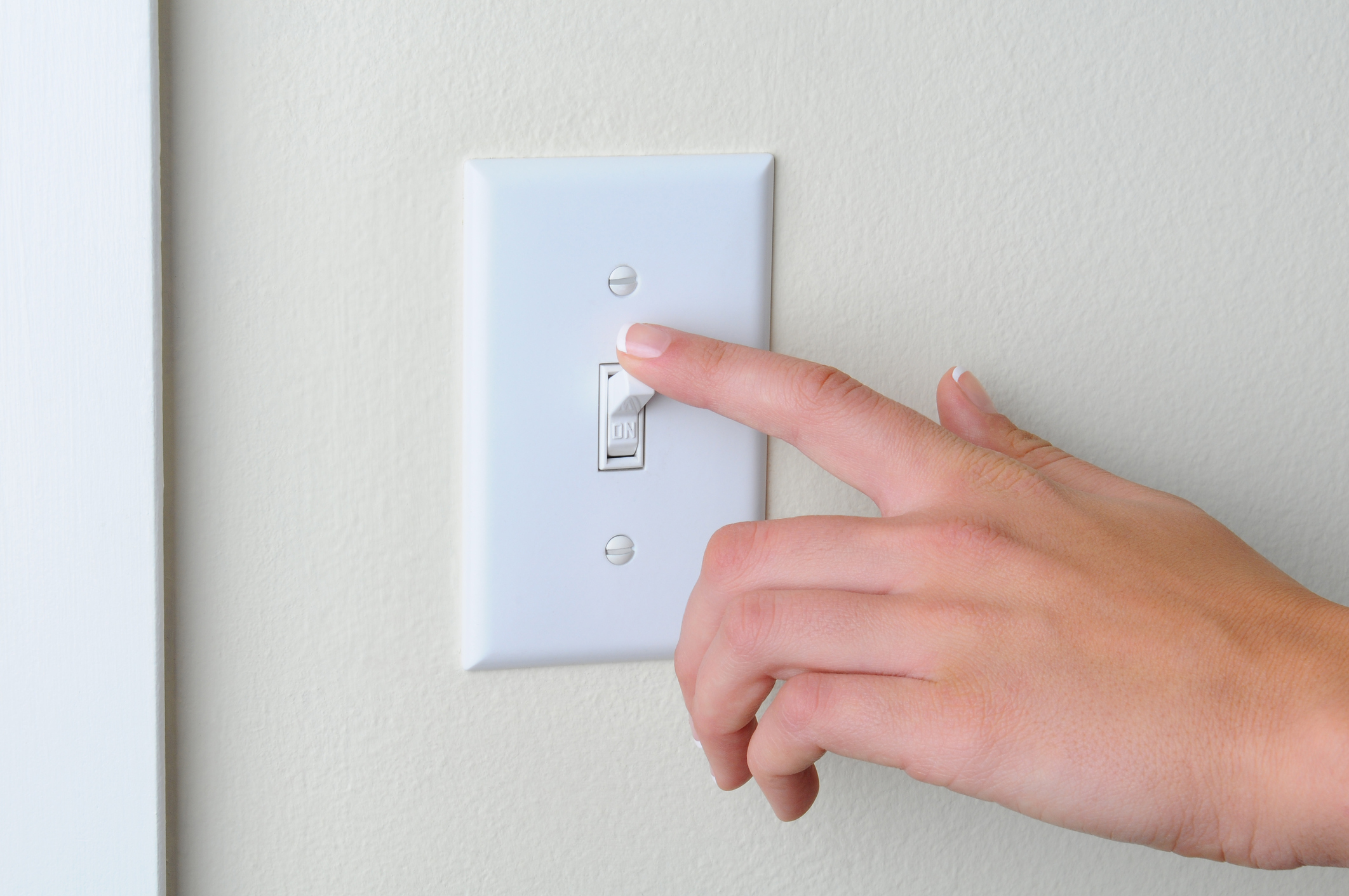 Finger touching light switch