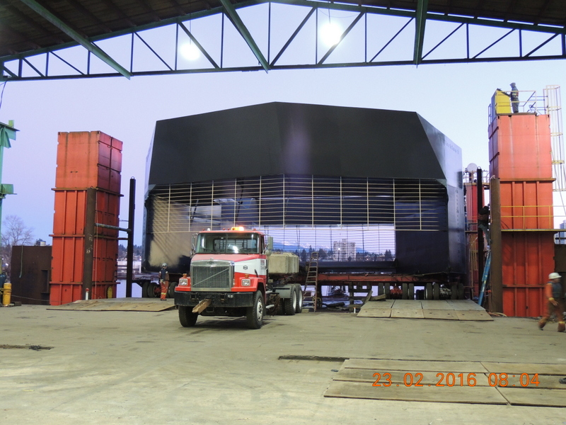 Water Wall Turbine Inc.'s vessel being moved from the fabrication shop to dry dock before being tested in the Vancouver area. February 23, 2016.