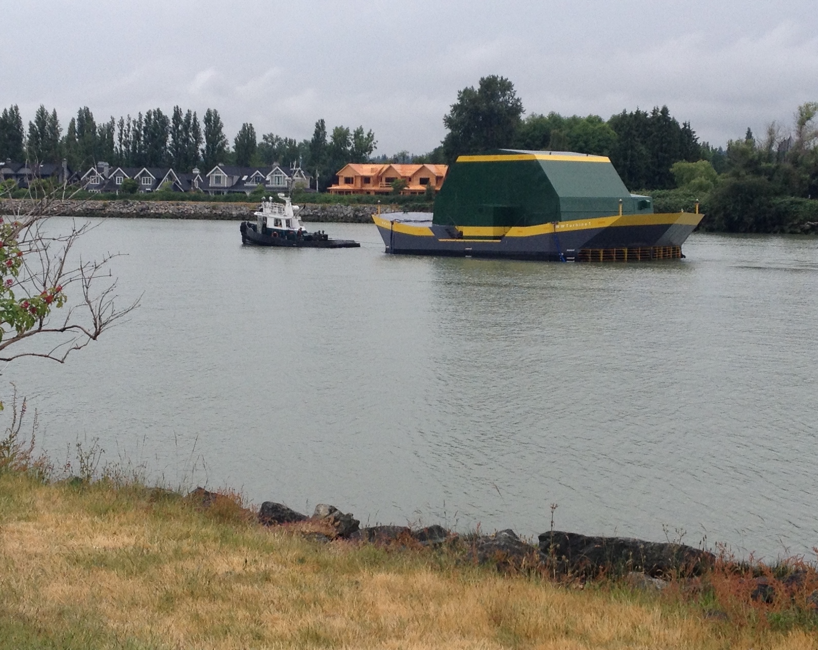 The Water Wall Turbine being towed from Richmond, BC along the North Arm of the Fraser River, towards Dent Island.