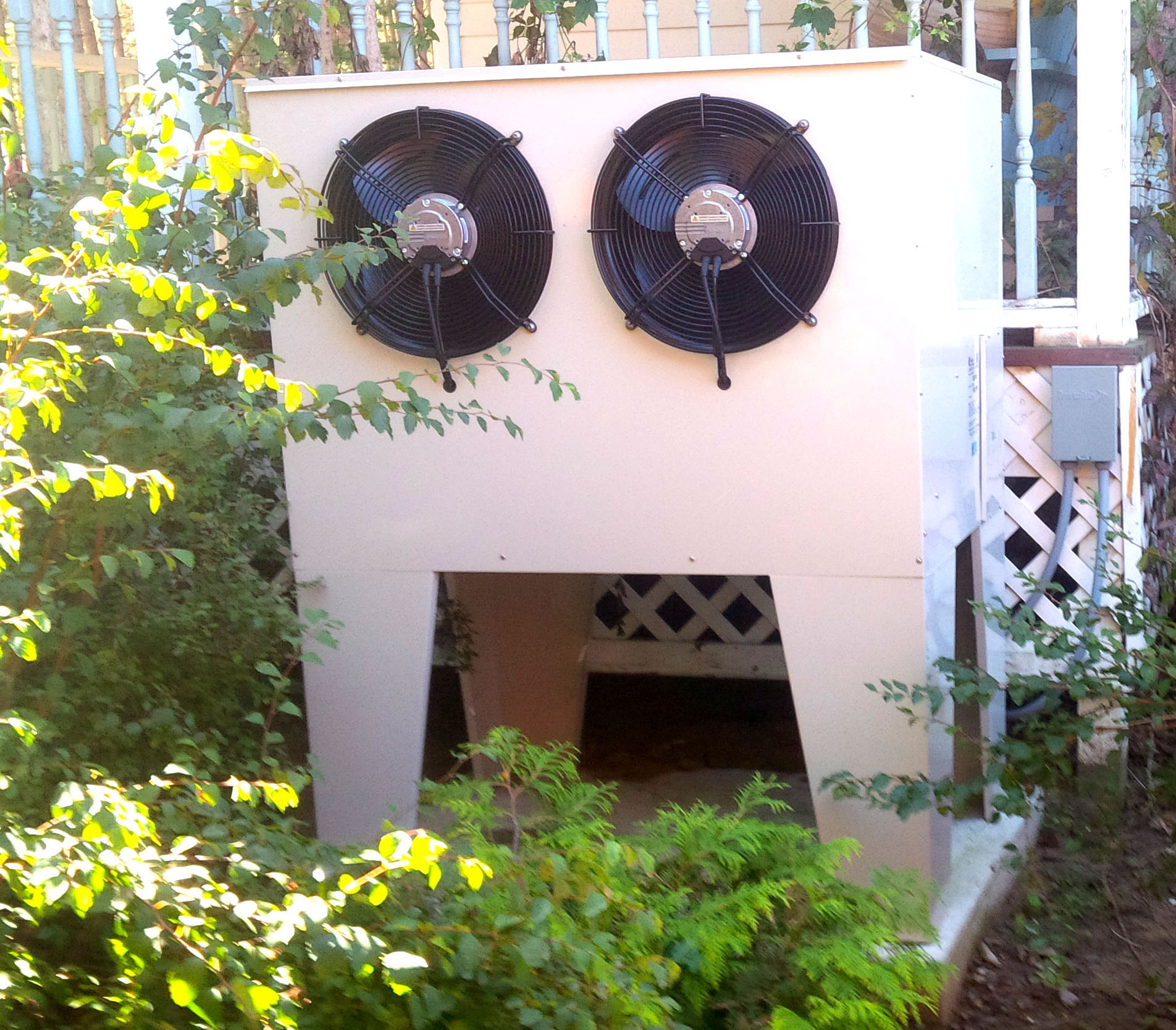 image of an outdoor unit of a cold climate heat pump (CCHP) system installed in the side yard of an existing home near Ottawa, Ontario