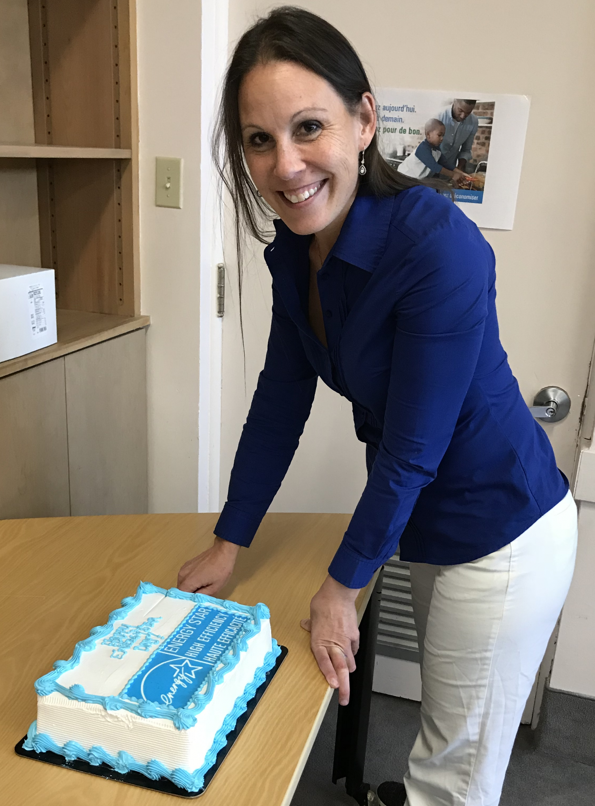 Woman cutting ENERGY STAR cake