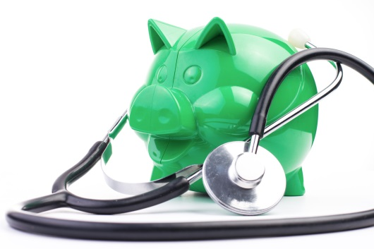 Piggy bank with stetoscope image