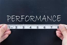 Measuring tape and the word performance above it