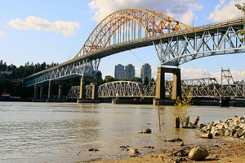 Photo of the view of the Patullo and railway bridges from Brownsville Bar Park in North Surrey, B.C. Photo credit: waferboard (Creative Commons)