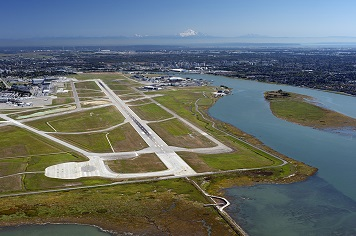 Aerial photo showing the close proximity of the Vancouver International Airport to the Fraser River. Photo credit: Josef Hanus (Thinkstock: 154420349)