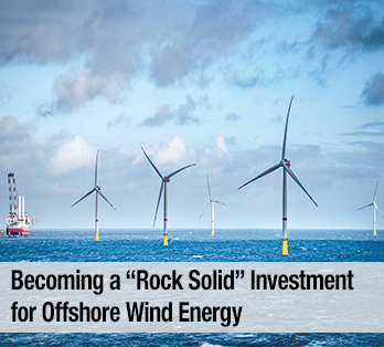 Five wind turbines in a body of water with a boat in the background - Becoming a rock solid investment for offshore wind energy