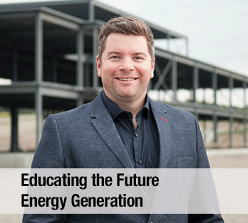 A man in a suit looks straight ahead - Educating the future energy generation