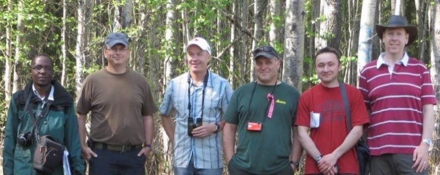 six Dothistroma team members standing in a forest. Photo: Tod Ramsfield