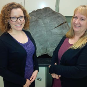 "Catherine McNalty, Tree Ring Technician, (left) and Trisha Hook, Climate Change Impact Technician, (right) with large spruce ""cookie"" sample. Photo: Ray Darwent"