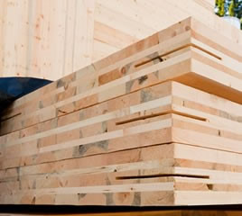 A stack of cross-laminated timber panels.