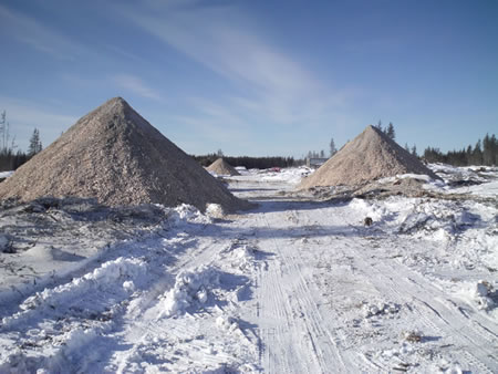 Wood chips from a biomass harvested site can be piled prior to transport to a bioenergy facility.