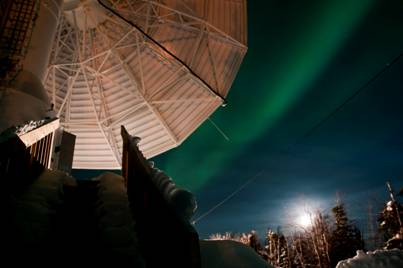 A dish antenna with the aurora behind it. (Copyright 2012 Terry Halifax Photography)