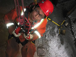 Picture showing an Indigenous woman working inside the Musselwhite Mine