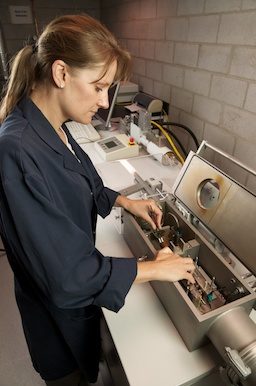 Woman working on physical simulation equipment.