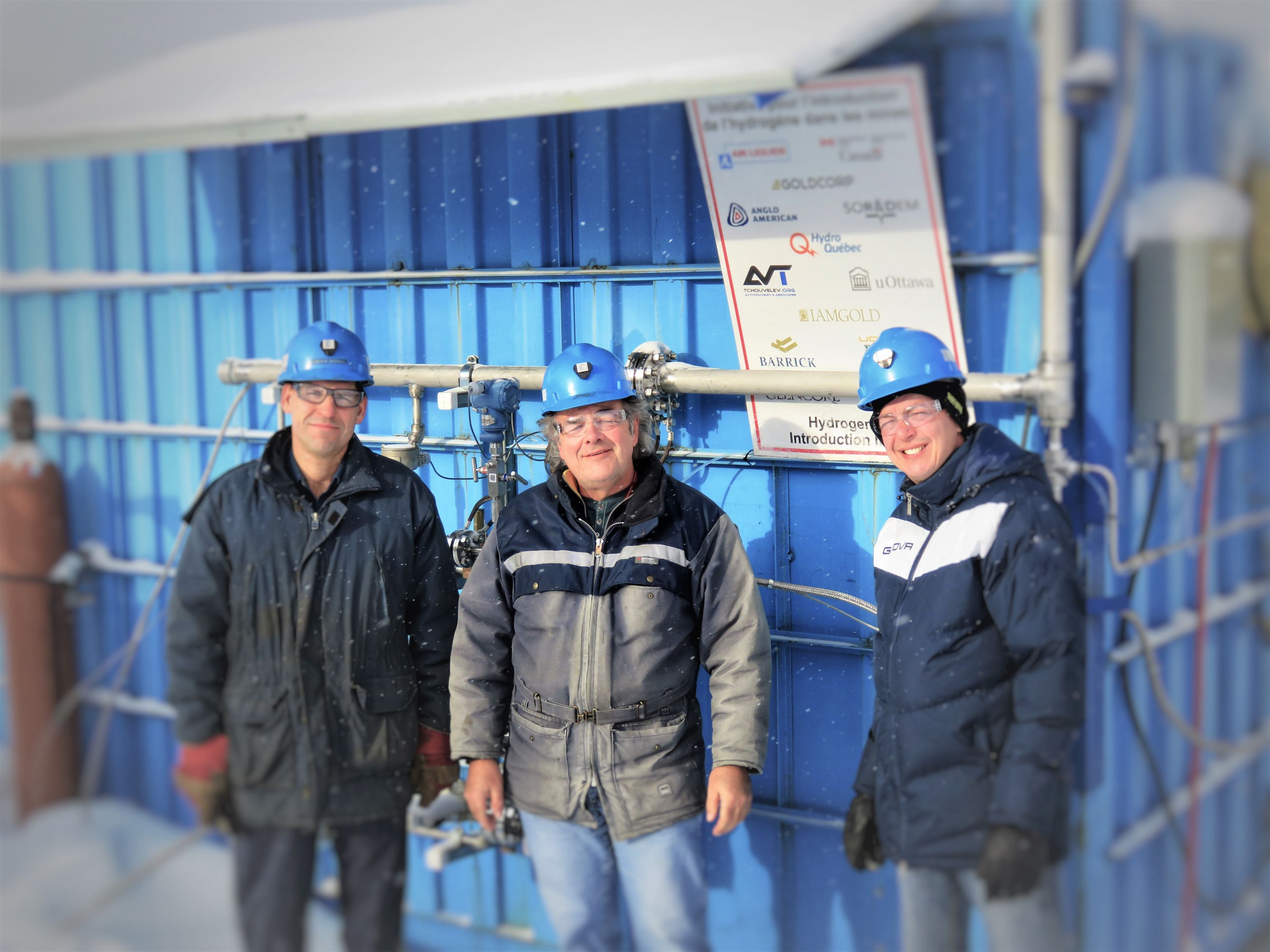 Part of the research team in front of the hydrogen test chamber in Val d'Or, Quebec.