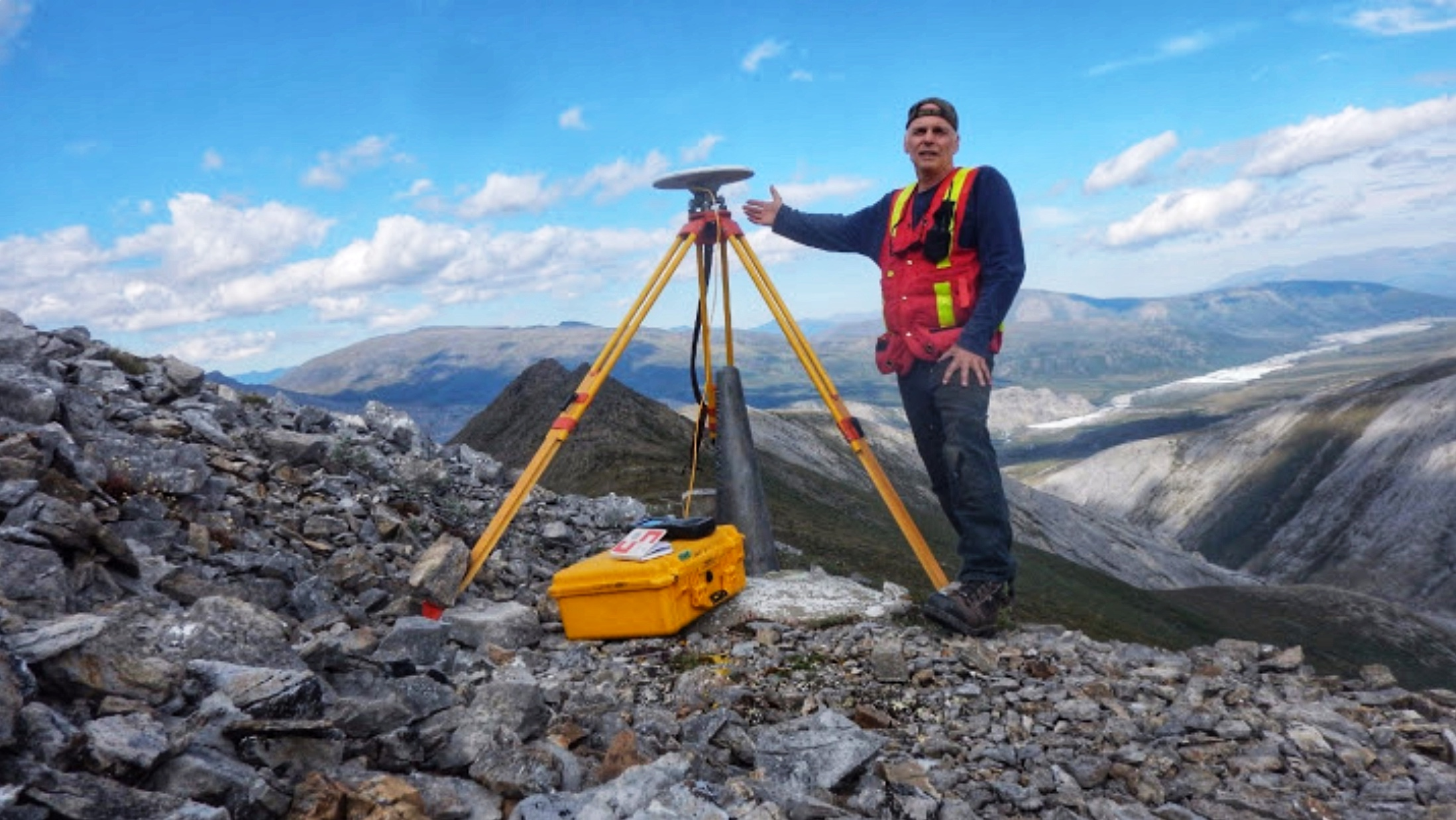 Joe records the coordinates of the Canada–United States boundary with a GNSS receiver at the Yukon–Alaska border.