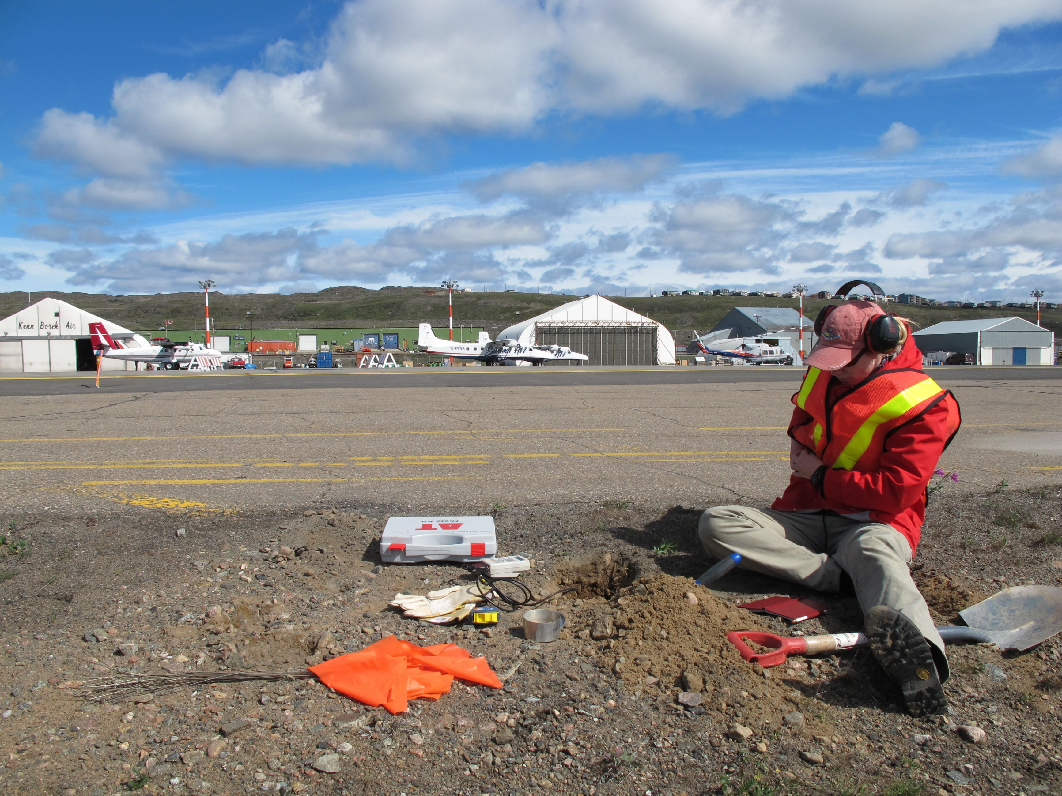 Image of a GSC scientist collecting permafrost monitoring data in Iqaluit, Nunavut