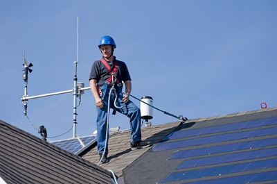 Frank surveys a recent installation of a new type of solar panel